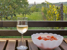 Glass of wine on wooden table with picturesque view Stock Photos