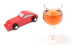 Glass of wine and wooden toy car. White background Stock Photography