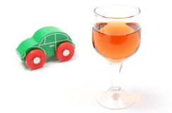 Glass of wine and wooden toy car. White background Stock Photo