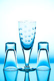 Glass wineglass It stands on the background. Glass wineglass It stands on the blue background Royalty Free Stock Image