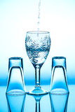 Glass wineglass It stands on the background. Glass wineglass It stands on the blue background Stock Image
