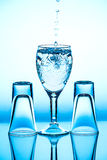 Glass wineglass It stands on the background. Glass wineglass It stands on the blue background Royalty Free Stock Photography