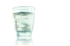 Glass of wisky, soda and ice. Isolated glass of wisky, soda and ice on the table with some condensed water drops outside the glass Royalty Free Stock Images