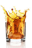 Glass With Splashing Whisky Drink Royalty Free Stock Images
