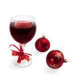 Glass With Wine And Christmas Full-spheres Royalty Free Stock Photography