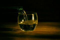 Glass on wood table dark background Stock Image