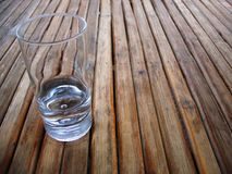 Glass on a wood table top Royalty Free Stock Image