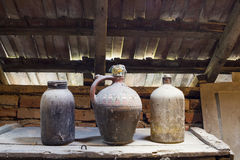 Glass, wooden and metallic objects in the attic with dust and spiderwebs Stock Photos