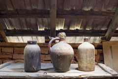 Glass, wooden and metallic objects in the attic with dust and spiderwebs Stock Photo