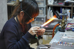 Glass worker. The girl who makes the glass things Stock Photo
