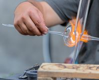 Glass worker in action on the street. Glass worker in action public demonstration on the street Royalty Free Stock Image