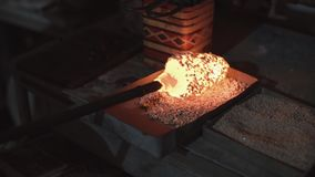 Glass workshop. Blowing glass products, the process of manufacturing the product, close up stock video footage