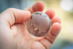 Glass world in your hands Stock Images