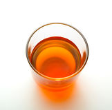Glass of yellow beverage, top view Royalty Free Stock Photo