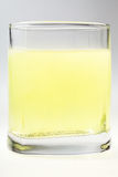 Glass of yellow carbonated water Royalty Free Stock Photography