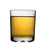 Glass with yellow fizzy cocktail, isolated Royalty Free Stock Images
