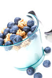 Glass of yoghurt with muesli and blueberries Royalty Free Stock Photos