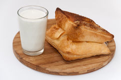 Glass of yogurt and bakery pastry on the wooden board Royalty Free Stock Photos