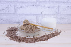 Glass of yogurt and flax seeds, whole and grounded Stock Image