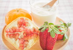Glass of yogurt with fresh mix fruit Royalty Free Stock Images