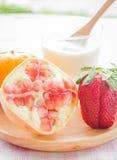 Glass of yogurt with fresh mix fruit Stock Images