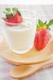 Glass of yogurt with fresh strawberry Royalty Free Stock Photos