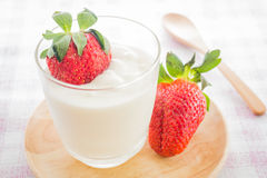 Glass of yogurt with fresh strawberry Royalty Free Stock Images
