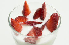 Glass of yogurt with strawberries Royalty Free Stock Photography