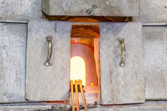 Glassblower's Oven. An Open Fiery Glassblower's Oven With Glass being Made Royalty Free Stock Photos