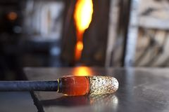 Glassblower shaping molten glass Royalty Free Stock Photo