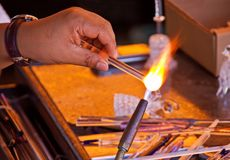 Glassblower working stock photography