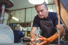 Glassblower working on a glass Royalty Free Stock Photography