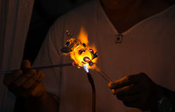 Glassblowing an elephant shape. Royalty Free Stock Images