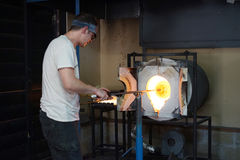 Glassblowing - into the forge Royalty Free Stock Photos