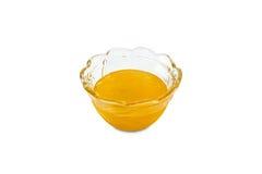 Glasschüssel mit Honig Lizenzfreie Stockbilder