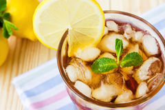 Glasse of ice tea with lemons and mint Royalty Free Stock Photos