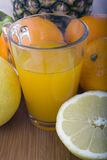 Glasse of orange juice and fruits. On wooden table Stock Photo
