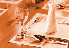 Glasse and plate on table in restaurant Stock Photography