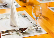 Glasse and plate on table in restaurant Royalty Free Stock Images