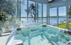 Glassed in jacuzzi by ocean. Summertime Stock Image