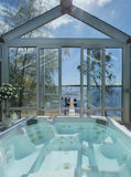 Glassed in jacuzzi by ocean. Summertime Royalty Free Stock Photography