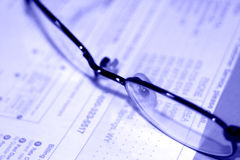 Glasses. Close up shot of glasses and some bills royalty free stock photography