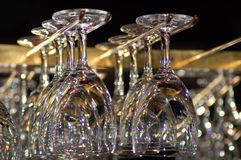 Glasses. Bar glasses on some kind a holder. Low light Royalty Free Stock Photography