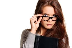 Glasses. Portrait of the young woman with the daily log in hands Stock Photos
