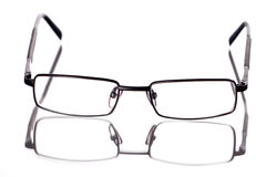 Glasses. Isolated on white background, reflected Royalty Free Stock Images