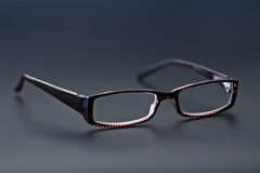 Glasses. (Eyewear) in gray background. Shot in studio stock image