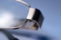 Glasses. Stylish glasses lying on a white background, macro photo royalty free stock images