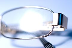 Glasses. Stylish glasses lying on a white background, macro photo Stock Photography