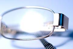 Glasses. Stylish glasses lying on a white background, macro photo stock photography