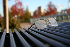 Glasses. Forgotten glases on the bench Stock Images